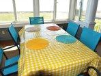 Sun porch dining table.