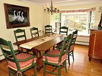 Dining room with seats for 8 and bay window.