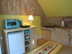 Fully stocked Kitchenette with the original cast iron sink and beadboard.