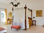Master bedroom and honeymoon suite. Period four poster bed and furnishings add to the opulent feel.
