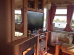 Flat screen tv. Stereo and radio.