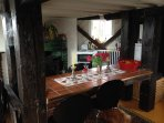 Kitchen with dining table. First floor and the entrance . Seats 6-8 people. Area 25 square meters.