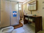 Large, ensuite master bathroom with toilet, bidet and shower.