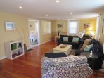 Living Room with comfy seating just off kitchen/ dining area- 61 Kelley Road West Harwich Cape Cod New England Vacation...