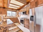 This kitchen has everything you need to prepare your favorite dishes.
