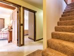 Head downstairs to discover the bedrooms!