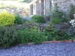 Raised stone wall flower beds