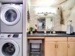 Main bathroom with washing machine and dryer.