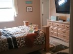 Master bedroom with walk-in closet and private bath and twin sleeper chair for small child