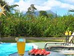 Grab a glass of juice, sit by the pool and watch the clouds roll past the volcano. Come stay with us