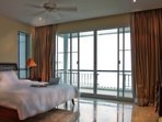 The Master bedroom. With a spacious balcony facing  the beach and the sea.