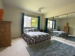 Bedroom 3. Queen bed. 3D Projector and mirrored closet doors. Beautiful wool rug