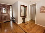 Entrance Hallway, shoe rack and 2 tone inlayed hardwood floors