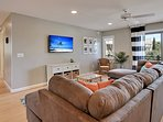 The first floor family room has a large HDTV for viewing shows and movies.