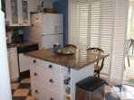 The kitchen is off the dining area and has an island makes it easy to gather.