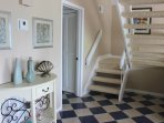 Take the stairs to the master bedroom.
