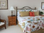 The large master bedroom suite has a king sized bed.