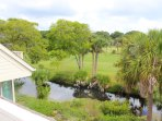 The deck offers views of the 18th hole of Crooked Oaks and the lagoon.