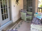 The screened porch has a sofa and glide chairs - perfect for relaxing.