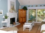 Soft blues and crisp whites, hardwood floors, and a beachy decor are highlights in this cottage.