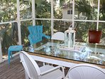 Enjoy afternoon appetizers around the table on the screened porch.