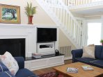 Gather around the fireplace and HDTV in the comfortable living room.
