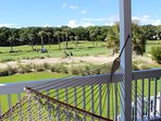 Step to the covered porch with views to the 10th hole of Ocean Winds.