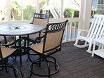 Off the kitchen is a screened porch. It has a table for 4 and rockers.