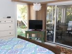 Sliding doors lead to the screened porch.