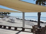 Beach Club's lounge area with chaises and protective sun sails; access to gorgeous 3 mile North Beach.