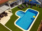 Pool area with summer kitchen and entertainment zone