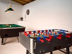 Leonhart billiard table and dart game next to the Foosball, outside area.