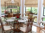 Dine around the table that seats 6. A door leads to an outside deck.