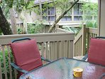There is a table for four on the outside deck.