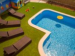 Pool area with 4 nice lunge chairs and playground for the youngest