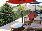 Enjoy drinks while lounging on the upper deck wicker furniture. Barbecue on the gas grill.