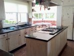 Fully fitted kitchen with range cooker, nespresso coffee machine, microwave etc