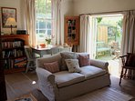 The double height sitting room - bright and sunny