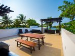 Roof top with pool, sitting area, BBQ grill.