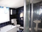 Spacious bathroom with large separate shower.