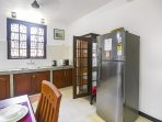 Kitchen + Dining area.The dining room *** kitchen has a table with 10 chairs