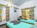 Bedroom 3.Each bedroom comes with their own seating spaces, ceiling fan, wardrobe, mirror, bedside table and table lamp