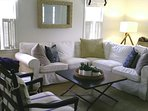 Open concept dining / living area with comfortable furnishings