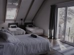 Double and two single beds with balcony and loft window