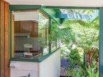 The kitchen bay window offers a pretty view to the private garden.