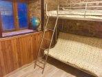 Kids room, with a triple bunk bed, can be used as a sofa