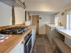 Fully equipped kitchen overlooks the pretty garden