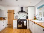 The sociable kitchen space is the heart of the cottage