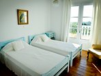 Twin beddded room with sea views