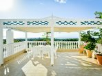 Covered top balcony with panoramic views of the sea and Mount Ainos..